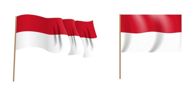 カラフルな自然主義的な手を振るモナコの旗