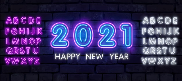 Colorful neon 2021 happy new year neon banner. realistic bright neon billboard on brick wall. concept of holiday card