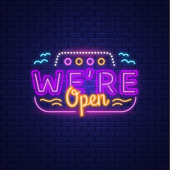 Colorful neon 'we are open' sign