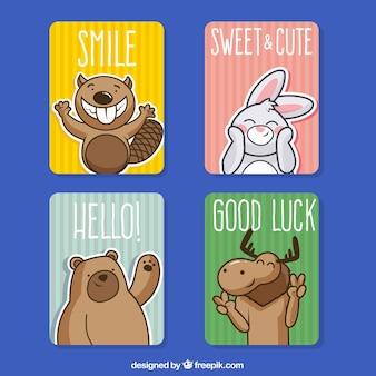 幸せな動物とカードのカラフルなパック