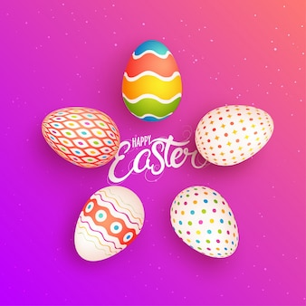 Colorful painted easter eggs on shiny pink background