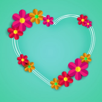Colorful paper flowers with heart shape frame on green background.