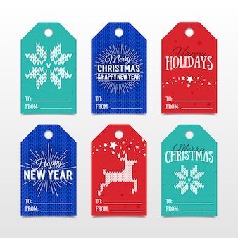 ハッピーホリデーメリークリスマスと新年あけましておめでとうございますのレタリングとプレゼントのためのカラフルな紙のタグ