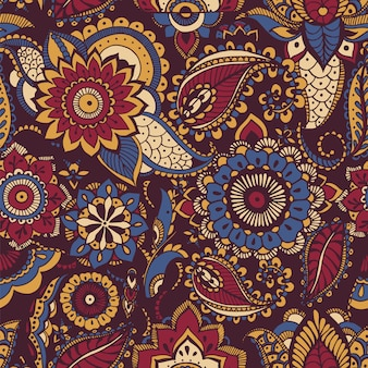 Colorful persian paisley seamless pattern with buta motif and oriental floral mehndi elements on dark background