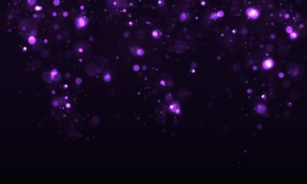 カラフルな紫のボケ効果。きらめく魔法のほこりの粒子。魔法の概念。