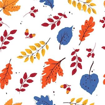 白い孤立した背景の葉とカラフルなシームレスな秋のパターン。あなたのデザインのために。