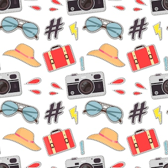 Colorful seamless pattern with cute retro cameras, suitcase, sunglasses
