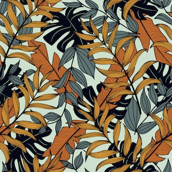 Colorful seamless pattern with dark and yellow tropical plants and leaves