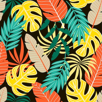 Colorful seamless pattern with tropical plants and leaves