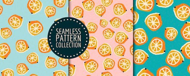 Colorful set of hand-drawn lemons seamless patterns