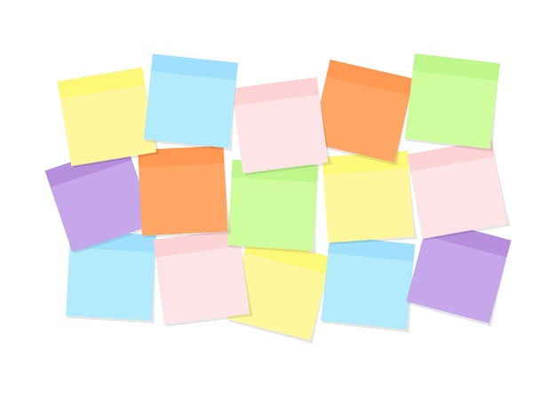 Colorful sticky note paper attached to board for memory notations, messages or tasks
