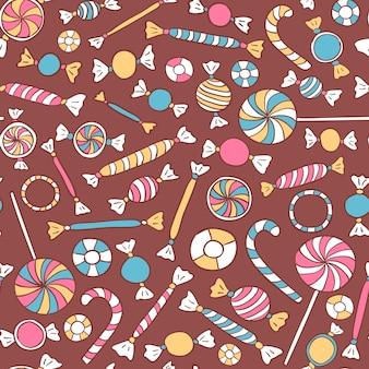 カラフルなお菓子のシームレスなパターン。キャンディーベクトル背景手描き