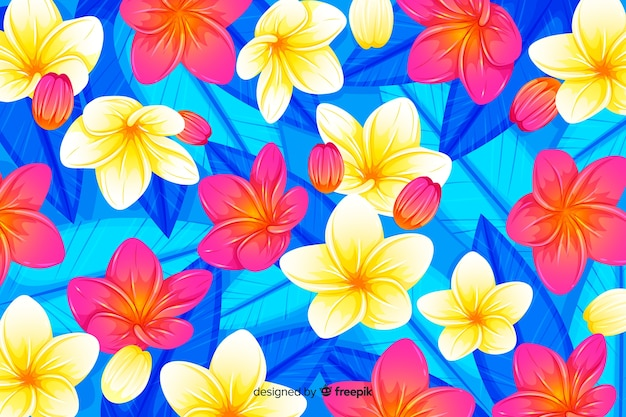 Colorful tropical flowers and leaves background
