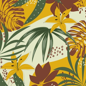 Colorful tropical leaves and flowers on a beige background