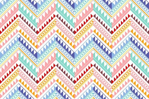 カラフルなヴィンテージジグザグ民族幾何学的な東洋のシームレスな伝統的なパターン。背景、カーペット、壁紙の背景、衣類、ラッピング、バティック、ファブリックのデザイン。刺繡スタイル。ベクター。