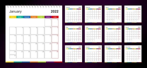 暗い背景に2022年のカラフルな壁掛けカレンダー、週は月曜日に始まります。