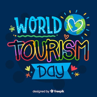 Colorful world tourism day lettering background