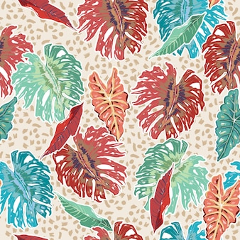 Colourful exotic tropical plants and monstera leaves