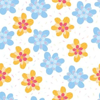 青と黄色の花のカラフルな花のシームレスなパターンの夏の背景