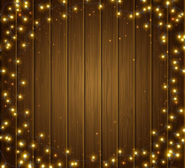 Красочные светящиеся рождественские круглые гирлянды на деревянной текстуре