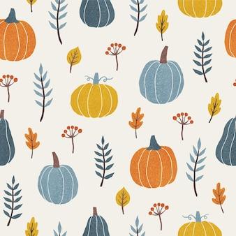 カラフルなカボチャの葉と枝季節の秋のシームレスなパターンベクトル図