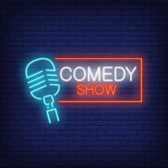 Comedy show neon sign. microphone with rectangular frame on brick wall background.