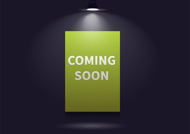 Coming soon message illuminated with light projector.