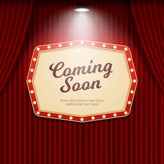 Coming soon retro theater sign illuminated by spotlight on cinema curtain background