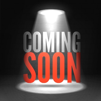 Coming soon in stage spotlight on dark background.  scene illuminated spotlight.