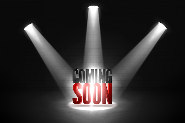Coming soon in stage spotlight on dark background.