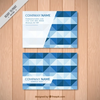 Company card with geometrical blue shapes