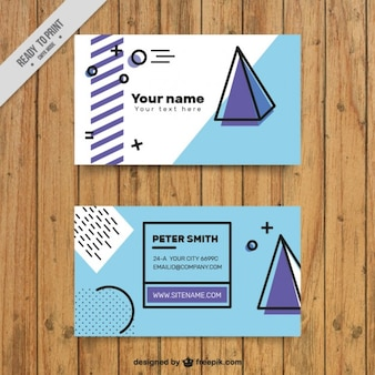 Company card with pyramid and abstract shapes