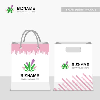 Company shopping bags design with pink theme and leafs logo