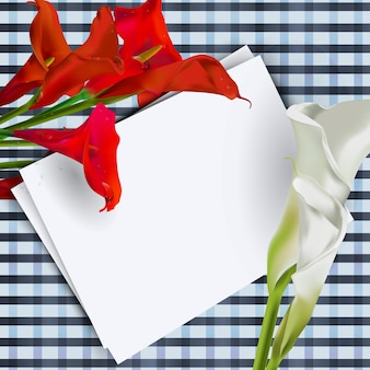 Composition of calla flowers with a white sheet of text on the table.