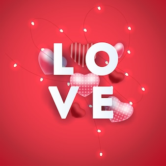 Composition with love inscription lettres and abstract balloon heart elements.