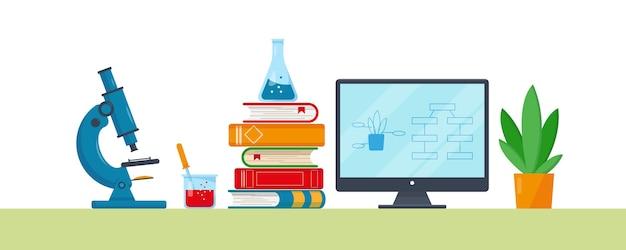 研究室用のコンピューター、本、植物、科学機器。