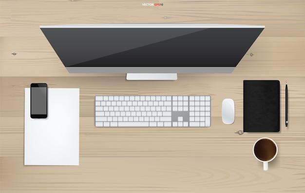 コンピュータは木の上のオフィスオブジェクトと作業スペースの背景を表示します。ベクトルイラスト。