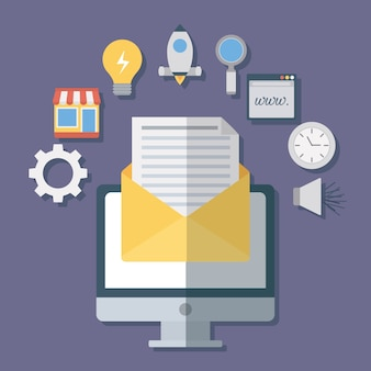 Computer and envelope with digital marketing related icons