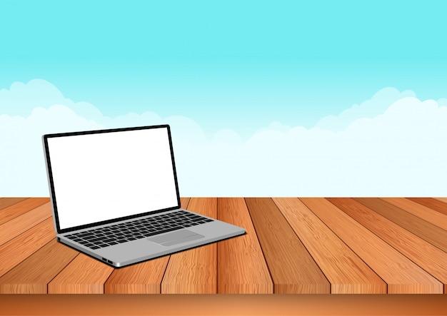 コンピューターのノートは自然の空と木の床に配置されます。