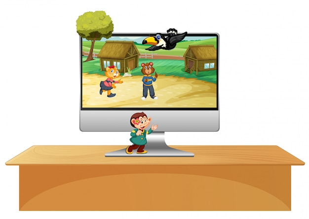 動物のテーマのデスクトップの背景を持つテーブル上のコンピューター