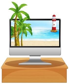 画面上のビーチとテーブルの上のコンピューター