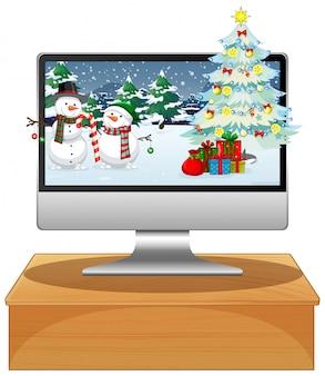 クリスマスデスクトップの背景を持つテーブル上のコンピューター