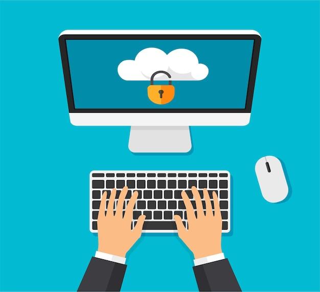 画面上にロックされたクラウドストレージを備えたコンピューターファイル保護手がキーボードで入力しています