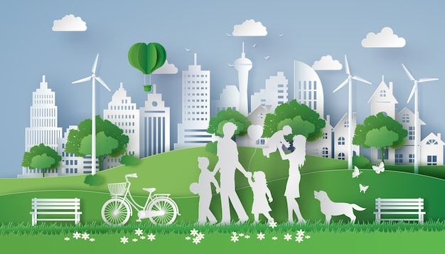 Concept of eco with happy family walking on the field