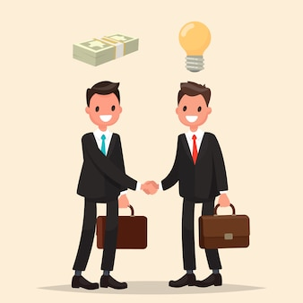 Concept of investment in the business. two businessmen shake hands, signing an agreement.