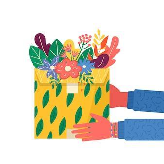 花と配達アイコン用の粘着テープ付きのカートンパッケージの概念。郵便小包、パック、箱。オンライン配達サービスの概念のために手持ちの小包を持っている宅配便。分離されたベクトル