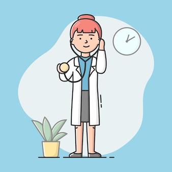聴診器と制服を着た若い魅力的な医師の医療スタッフの概念