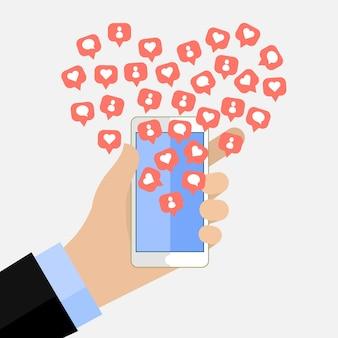 ソーシャルネットワーキングでの人気の概念。トップユーザー。いいねとスマートフォンを持っている男性と友達通知アイコンを追加します。
