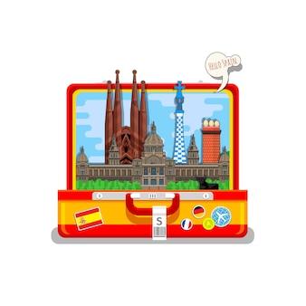 スペインへの旅行またはスペイン語の勉強の概念。オープンスーツケースのランドマークとスペインの旗