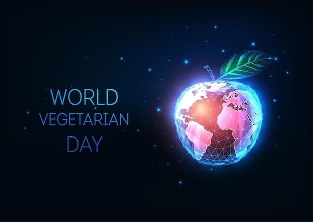 抽象的な光るリンゴと世界の地球儀と世界ベジタリアンデーの概念